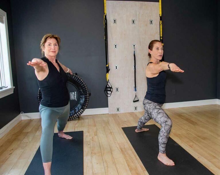 Body Lab GB - Bridget Hughes with Client Warrior Pose
